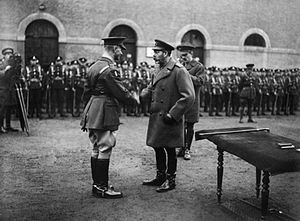 Daniel Beak - King George V presents the VC to Commander Daniel Beak at Valenciennes, 6 December 1918