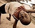 Dar es Salaam boy playing in the streets.jpg