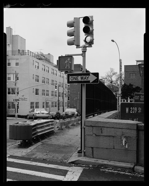 File:Deck of West 232nd Street overpass, showing wide W beam collision barrier, double-faced wooden guardrail, pedestrian fencing in front of parapet, pedestrian ramp, crosswalk, traffic HAER NY-334-80.tif