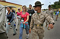 Defense.gov News Photo 120725-D-NI589-004 - Participants of the DoD s Joint Civilian Orientation Conference march under the watchful eye of Drill Instructor Sgt. Gustava Brown at the Marine Corps Recruit Depot in S.jpg