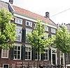 foto van Pand ter breedte van vijf vensterassen, parterre, verdieping en lage bovenverdieping