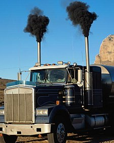 Diesel exhaust from a large truck starting up in USA with old technology device.