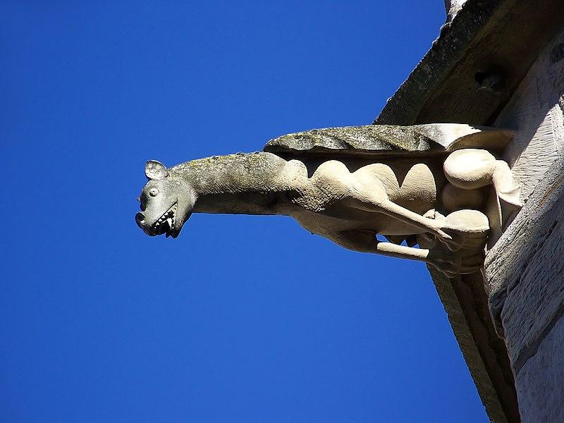 A gargoyle on the chevet of the church Notre-Dame in Dijon.