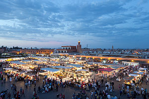 Jemaa el-Fnaa - Jamaa el Fna in the evening, looking toward Café Argana and the covered souq.