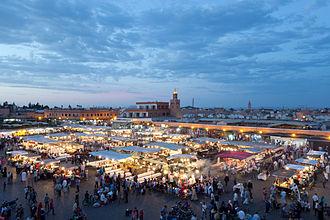 Jemaa el-Fnaa - Jemaa el-Fnaa in the evening, looking toward Café Argana and the covered souq.