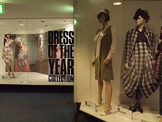 Dress of the Year - Dress of the Year exhibit at the Fashion Museum, Bath. From left to right, outfits by Christopher Kane (2013), Mary Quant (1963), and John Galliano (1987).