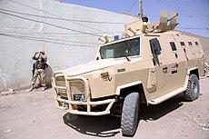 Dzik APC transports Iraqi army soldiers.jpg