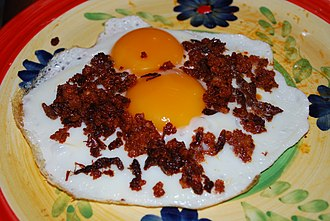 Chapulines - Fried egg with Oaxacan chorizo and chapulines
