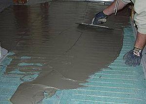 Underfloor heating - Electric floor heating installation, cement being applied