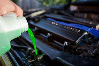 Radiator (engine cooling) - Coolant being poured into the radiator of an automobile