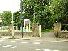 Photograph of an external wall and a gate at the boundary of Operator Paul.