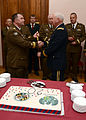 Estonian Defense Forces Brig. Gen. Meelis Kiili, left, the commander of the Estonia Defense League, gives a gift to U.S. Army Maj. Gen. James Adkins, right, the adjutant general of the Maryland National Guard 130605-Z-YE885-005.jpg