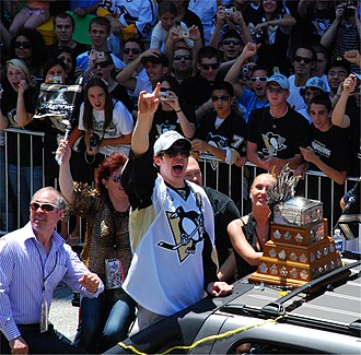 Evgeni Malkin - Malkin, along with his parents (left), during the Penguins' victory parade for their 2009 Stanley Cup victory.