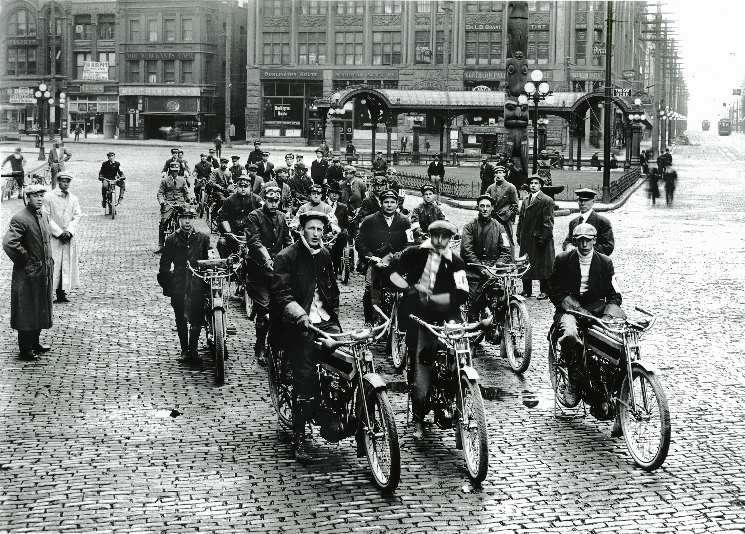 Black and white photo of motorcyclists