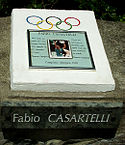 A plaque honoring Casartelli with a picture of him in the center.
