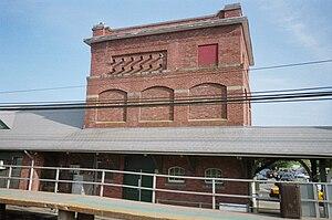 Huntington Railroad - Farmingdale Station still has the supports for Huntington Railroad's overhead wires.