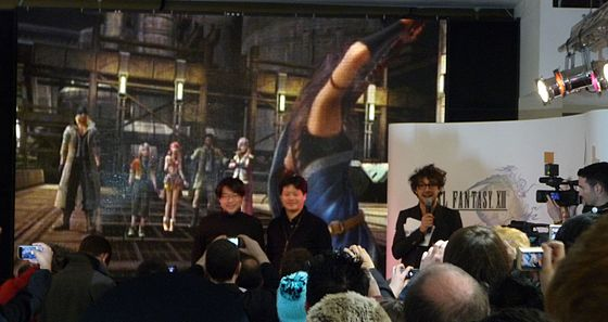 Art director Isamu Kamikokuryo (left) and producer Yoshinori Kitase (right) at the Final Fantasy XIII London Launch Event at HMV in March 2010, which was hosted by Alex Zane (holding microphone). Final Fantasy XIII Launch.jpg