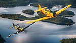 Finnish Air Force Hawker Hurricane warbird and US Navy T-6 Texan warbird in flight over Finland.jpg