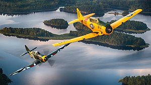 Warbird - Image: Finnish Air Force Hawker Hurricane warbird and US Navy T 6 Texan warbird in flight over Finland