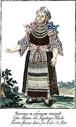 Finnish woman wearing a national costume.jpg