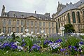 Flowers and backside of Palace Tau in Reims, France.jpg