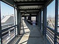 Footbridge from JFK UMass station to Columbia Road, April 2016.JPG