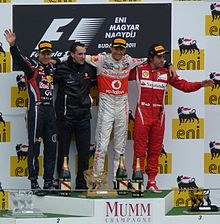 Photo du podium : Jenson Button devance Sebastian Vettel et Fernando Alonso.