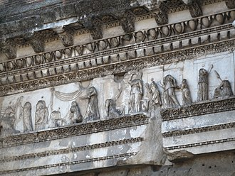Forum of Nerva - Arachne myth from the Colonnacce. In the middle Arachne can be seen cowering as Minerva smites her.