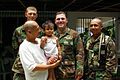 From background left, U.S. Navy Equipment Operator Constructionman William Wardwick, Hospital Corpsman 3rd Class Christopher Thomas and Equipment Operator 1st Class Jose Murphy pose for a picture with Ma Fe Ysa 090407-M-TF338-026.jpg