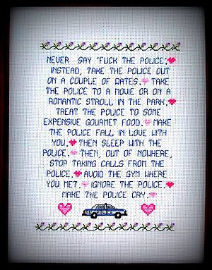 Fuck tha Police - Never Say Fuck the Police by Crafterdark captures a pop culture meme in cross-stitched form that recalls the N.W.A. song.