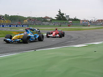 2005 San Marino Grand Prix - Alonso and Schumacher battle for the lead in the closing stages of the race.