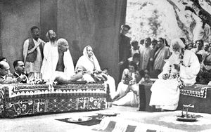 Political views of Rabindranath Tagore - Tagore (at right, on the dais) hosts Mahatma Gandhi and wife Kasturba at Santiniketan in 1940.