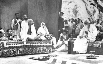 Political views of Rabindranath Tagore - Tagore (at right, on the dais) hosts Mahatma Gandhi and wife Kasturba at Santiniketan in 1940.