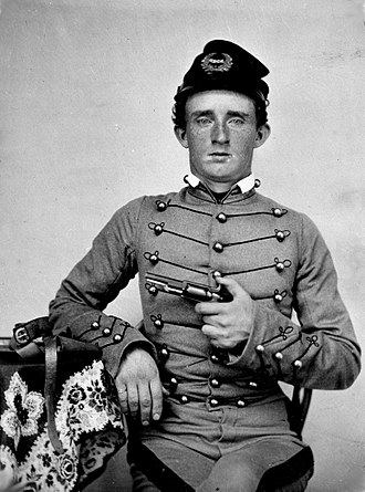 "George Armstrong Custer - USMA Cadet George Armstrong ""Autie"" Custer, ca. 1859 with a Colt Model 1855 Sidehammer Pocket Revolver."