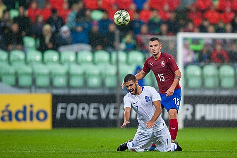 Georgios Ntaviotis and Daniel Souček in an internatinoal association football match of European Under-21 Championship Qualifying Round between the Czech Republic and Greece