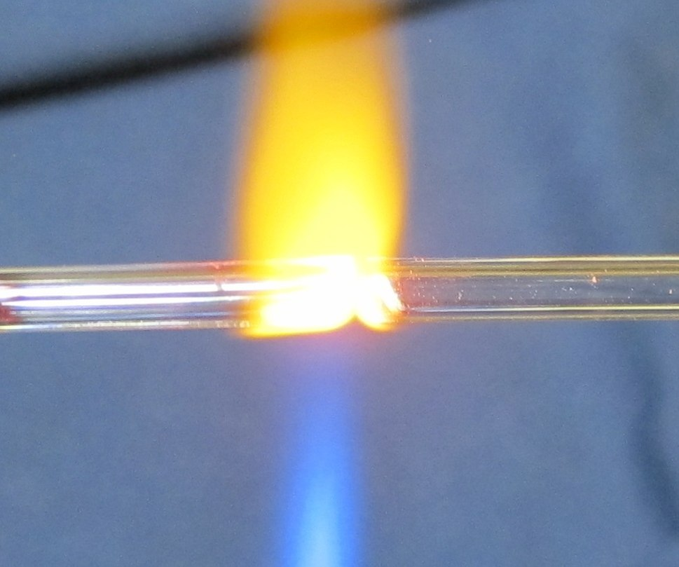 Glass welding two tubes together