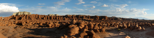 hundreds of sandstone hoodoos protruding from the desert floor.