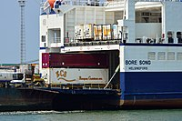 Gooseneck trailer on terminal tractor unloading RoRo ship Bore Song.jpg