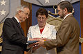 Gordon England presents the Medal of Honor flag to Ross McGinnis's parents.jpg