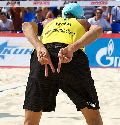 "Brazil's Emanuel Rego signals for an ""angle"" block for the opposing player on the left and a ""line"" block for the opposing player on the right Grand Slam Moscow 2011, Set 2 - 030.jpg"