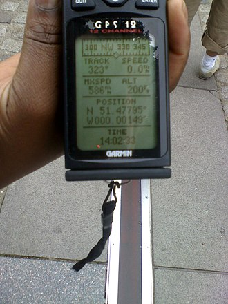 Prime meridian (Greenwich) - A GPS receiver at the marking strip of the prime meridian. The indicated longitude is not exactly zero because the geodetic zero meridian on a geocentric reference ellipsoid (which is what GPS positioning yields) is 102.478 metres east of this strip.