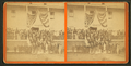 """Group of men and women posing on steps of large building, flag draped overhead, and a sign reading """"Headquarters First ME Cavalry"""", from Robert N. Dennis collection of stereoscopic views.png"""