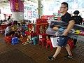 HK Wan Chai 堅拿道 Canal Road West Da Siu Yan 打小人 Villain hitting n plastic seats Oct-2015 DSC female visitors.JPG