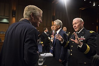 Angus King - Martin Dempsey (right), speaks with King (left) at Senate Armed Services Committee meeting in 2014.