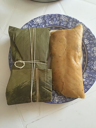 Hallaca - A prepared hallaca. Wrapped inside the banana leaves and cooked, without the leaves ready to be served.