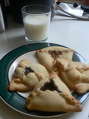 Hamantaschen with a glass of milk. Poppy seed ...