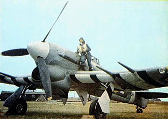 Gloster Aircraft Company - Wartime photograph of a Hawker Typhoon. Note the black and white identification stripes under the wings