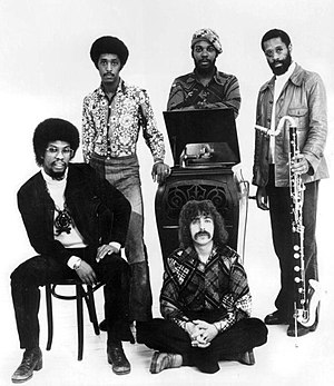 Bennie Maupin - The Headhunters in 1975. Maupin is on the right, holding a bass clarinet