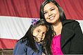 Hillary Paulino, right, and her daughter pose for a photo at Mountain Home Air Force Base, Idaho, Oct. 3, 2013, while they wait for Airman 1st Class Michael Paulino, an ammunition technician with the 366th 131003-F-WU507-101.jpg
