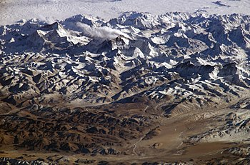 Perspective view of the Himalayas and Mount Everest as seen from space looking south-south-east from over the Tibetan Plateau. (annotated version)